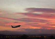 1 восход солнца самолета Стоковая Фотография