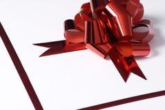1 красный цвет смычка присутствующий Стоковые Фотографии RF
