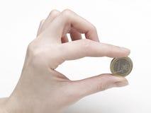 1 монетка поставляя женщину руки s евро Стоковая Фотография RF