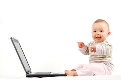 1 потеха младенца имея компьтер-книжку Стоковая Фотография RF