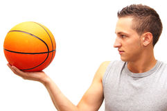 1 on 1. A basketball player holds the ball in front of his face Royalty Free Stock Photo