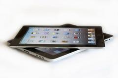 1 2个苹果ipad与 库存图片