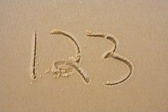 1.2.3, im Sand Lizenzfreie Stockbilder