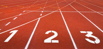 1 2 3 Running track. Start track. Lanes 1 2 3 of a red racing track Stock Image