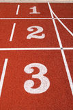 1 2 3 on a running track. Stock Image