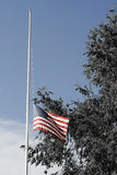 1/2 Staff American Flag. American Flag at half staff. Selective de-saturation, somber colors Royalty Free Stock Image