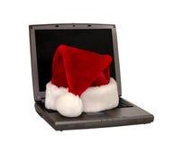 1 3个帽子膝上型计算机圣诞老人开会 免版税图库摄影