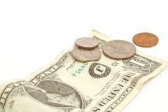 $1 bill & change. Shot of $1 bill & change Royalty Free Stock Photo