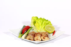 1.crispy springrolls on dish with salad. On the white background Royalty Free Stock Photography
