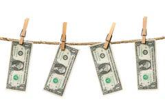 1 Dollarscheine, die von einem Seil hängen Lizenzfreies Stockbild