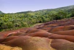 1 färgade jord mauritius sju Arkivfoto