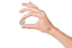 1 holding för mynteurohand Arkivfoton