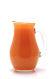 1 litre pot full with orange juice Royalty Free Stock Photo
