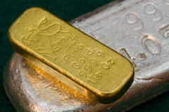 1 Ounce Gold Bullion Bar (ingot) Silver Bar Below Stock Photo
