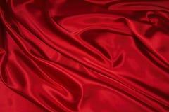 1 röda satängsilk för tyg Arkivbilder