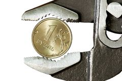 1 ruble in adjustable spanner Royalty Free Stock Photography