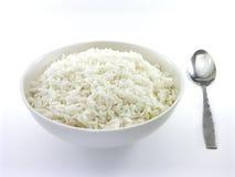 1 skedwhite för rice 2 Arkivfoto
