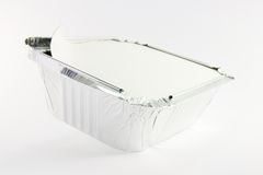 1 square foil partly opened catering tray. One square foil partly opened catering tray on a white background Royalty Free Stock Photography