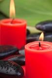 1 stearinljus röda hotstones Arkivbilder