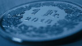 Free 1 Swiss Franc Coin Close-up. Dark Blue Background Or Wallpaper On An Economic, Business, Entrepreneurial Or Financial Theme. Money Stock Photo - 215563560