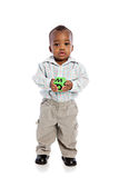 1 year old baby boy standing holding a block Stock Photography