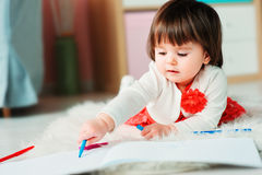 Free 1 Year Old Baby Girl Drawing With Pencils At Home Stock Photos - 88620603