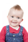 1 year old baby girl smiling at the camera Royalty Free Stock Images