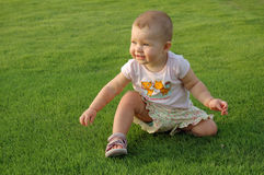 1 year old baby on grass. Baby outdoors on the grass Royalty Free Stock Photo