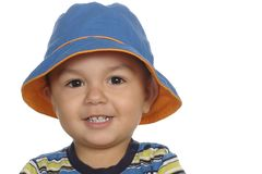 1-year-old boy with blue hat. A cute hispanic one-year-old boy wearing a blue fisherman hat, isolated on white background Stock Photography