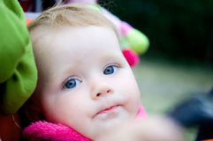 1 year old girl  in baby carriage Royalty Free Stock Photo