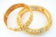 1 złote bransolety obraz stock