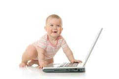 10个婴孩小查出的膝上型计算机 库存照片