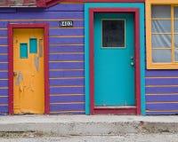 10个房子紫色 库存照片