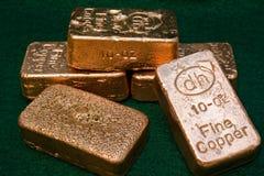 10个棒金块纯铜的盎司 免版税库存图片