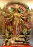 10 übergaben Durga Idol. Stockfoto