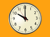 10:00 o'clock. A standard clock, with the time of 10:00 showing.  Isolated on an orange background Royalty Free Stock Photo