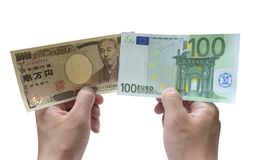 10,000 Yen and 100 Euro. On white background Royalty Free Stock Image