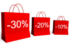 10, 20, and 30 Percent Off Sales. Rendered shopping bags indicating 10, 20, and 30 percent off Royalty Free Stock Photo