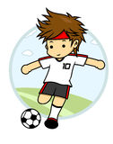 Футболист 10 пробует пнуть шарик Стоковые Изображения