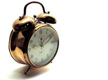 10 classic minutes past 9. An older alarm clock showing the time of ten past nine Stock Image