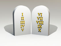 10 Commandments gold on stone tablet. Roman letters on stone tablet Stock Photo