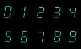 10 digitale Zahlen im Grün auf schwarzem Hintergrund Lizenzfreie Stockfotografie