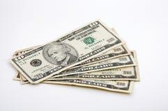10 Dollarscheine breiteten heraus auf Weiß aus Stockfotografie