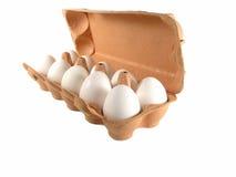 10 eieren in een doos Stock Foto's
