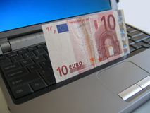 10 Euro on laptop. 10 Euro on notebook computer Stock Photos