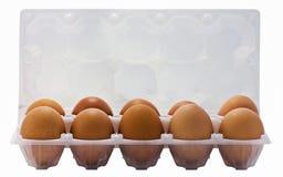 10 farbige Eier in einer Plastiktasche. Stockfotos