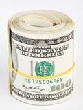 10 mila dollari US Hanno rotolato in su Fotografia Stock