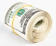 10 mila dollari US Hanno rotolato in su Fotografie Stock
