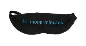 10 more minutes sleep mask. 10 more minutes black sleep mask Royalty Free Stock Image