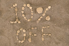 10 Percent Off. Pebbles on a beach arranged to spell out 10% OFF stock image